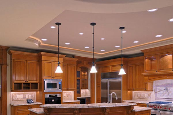 three hanging lights above a kitchen island